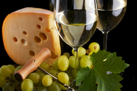cheeseboard: white wine and cheese on black