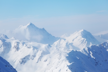 snowy mountain: top of alps in sky Stock Photo