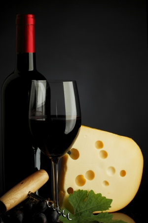 red wine and cheese on black photo