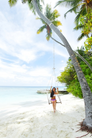 Beautiful woman swinging in beach hammock Stock Photo - 16392667