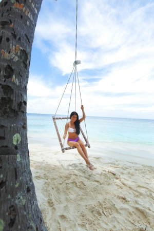 Beautiful woman swinging in beach hammock Stock Photo - 16391703
