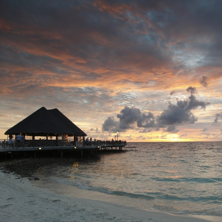 Beach of Maldives on sunset photo