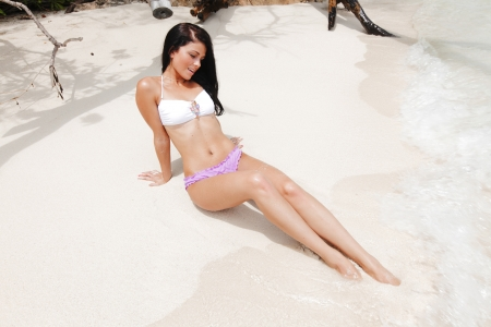 Beautiful sexy model relaxing on the beach photo