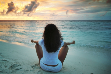Yoga woman in lotus pose on beach at sunset Stock Photo - 15981781