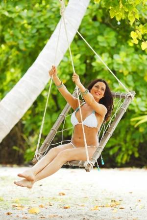 Beautiful woman swinging in beach hammock Stock Photo - 15993241