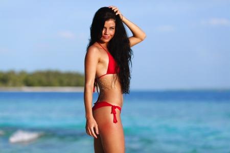 blue lingerie: Beautiful sexy woman in bikini posing on beach Stock Photo