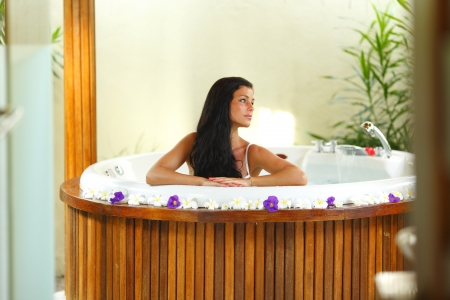 Pretty woman relaxing in a small pool of tropical hotel Stock Photo - 16392576