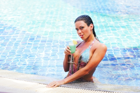 Beautiful woman in swimming pool with cocktail Stock Photo - 16792816
