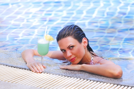 Beautiful woman in swimming pool with cocktail Stock Photo - 16792812