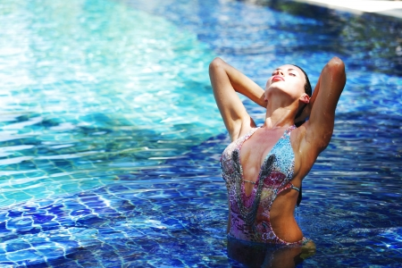 Sexy young woman standing in a swimming pool Stock Photo - 16792822