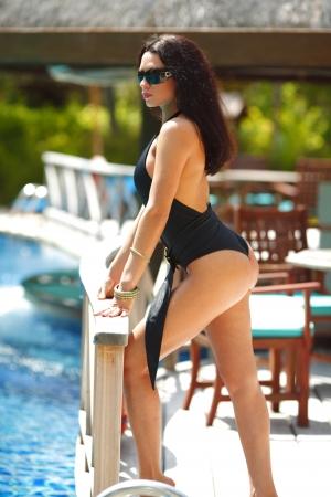 Beautiful woman posing on stairs of swimming pool Stock Photo - 16380944