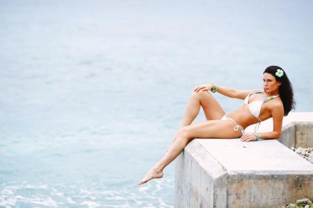 Beautiful sexy woman in bikini posing near sea Stock Photo - 16380851