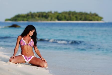 Beautiful sexy woman in bikini posing on beach Stock Photo - 16380844