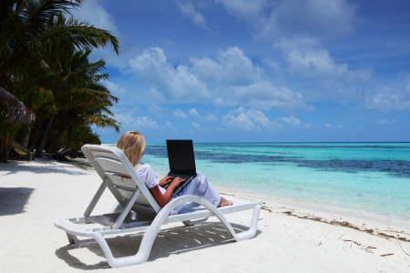 working model: business woman with laptop on beach
