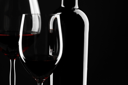 beverage menu: Red Wine Glass silhouette Black Background Stock Photo