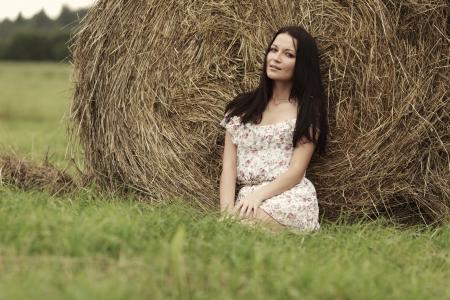 woman near haystack photo