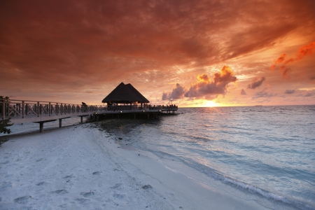 resort life: Beach and tropical resort hotel of Maldives on sunset