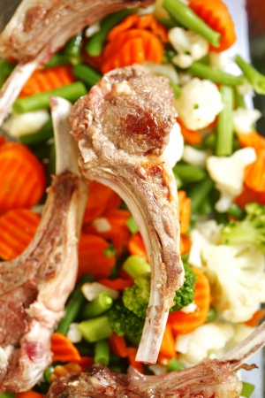 Appetizing roasted lamb ribs and vaus vegetables close-up Stock Photo - 17313749