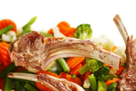 Appetizing roasted lamb ribs and various vegetables close-up Stock Photo - 17313701