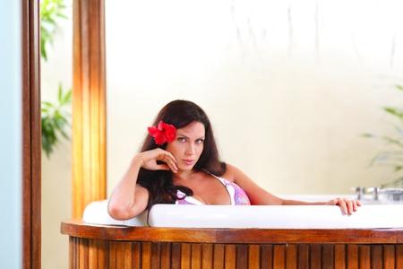 Pretty woman relaxing a tub Stock Photo - 17408996