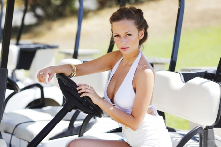 woman in golf car photo