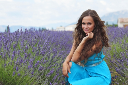 Woman sitting on a lavender field photo