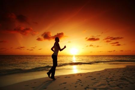 woman run on beach photo