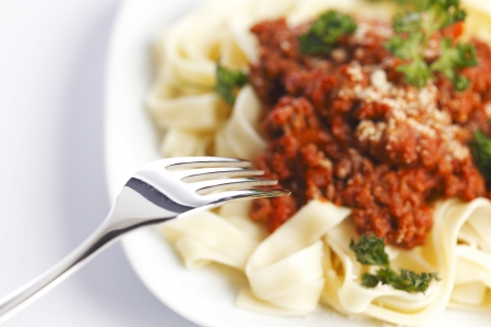 Spaghetti bolognese and fork, italian cuisine concept photo