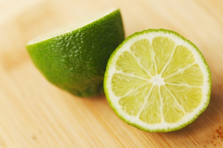 Cut lime on a wooden board close-up photo