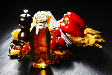 Pasta ingredients on black table, italian cuisine concept photo