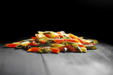 Colored pasta on black table photo