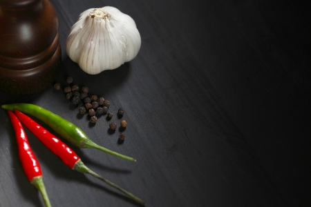 Spicy food on black table, italian cuisine concept photo