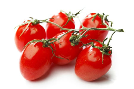 Bunch of cherry tomatoes isolated on white background photo