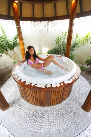 Pretty woman relaxing in bathtub of tropical hotel Stock Photo - 19687166