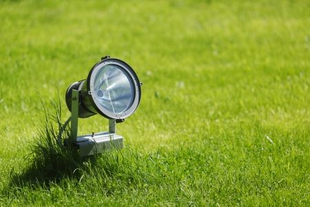 Garden lamp on background of green grass photo
