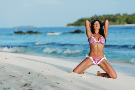 pink posing: Beautiful sexy woman in bikini posing on beach Stock Photo
