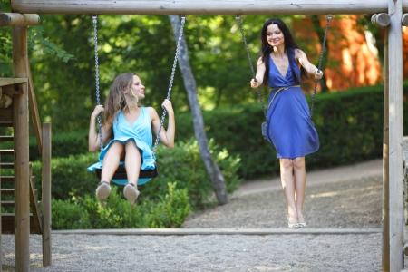 girl on swing: young women swinging Stock Photo