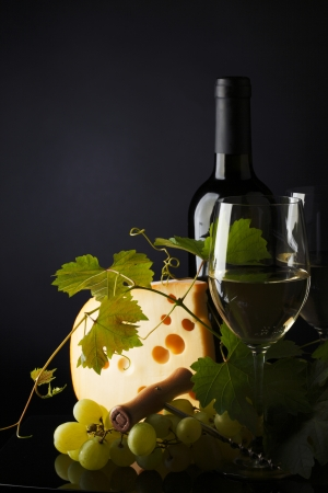 white wine and cheese on black photo