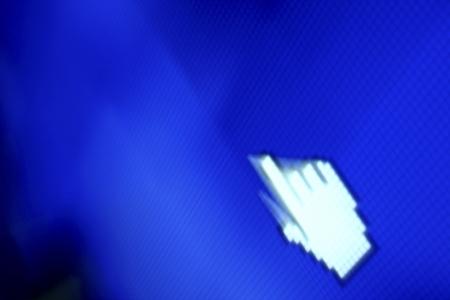 finger corsor on blue pixel screen Stock Photo - 21571865