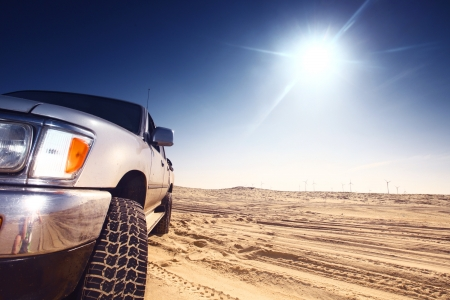sports track: truck in desert sand and blue sky