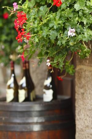 winemaking: Wine bottles on wodden barrel, winemaking concept