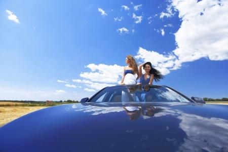 women dance in car photo