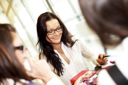smiling girl thinking on examinination photo