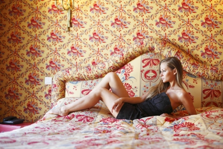 Beautiful woman on a sofa photo
