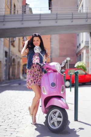 woman and pink motorbike photo
