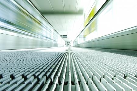 Blurred backround of moving futuristic escalator photo