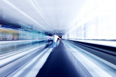 futuristic man: Man standing on moving futuristic escalator