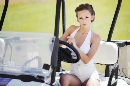 woman in golf car photo