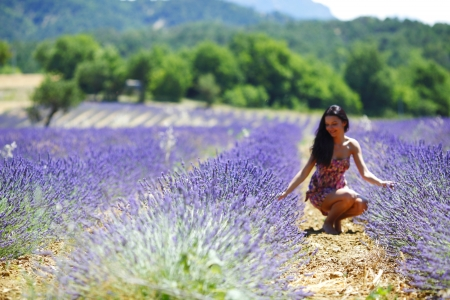 Woman standing on a lavender field photo