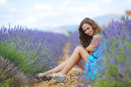 lavender field: Woman sitting on a lavender field